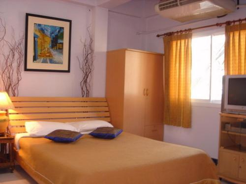 Booking - Hotel Siam House